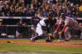 [6062]  (1of FIVE PICTURE SERIES) Boston Red Sox Mike Lowell is safe at home after Colorado...