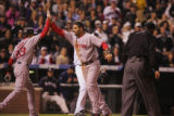 [6079]  Boston Red Sox Mike Lowell is congratulated by Julio Lugo after scoring in the fifth...
