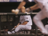 [5657]  Colorado Rockies Matt Holliday watches as Aaron Cook runs out a bunt to first base in the...