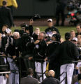 Colorado Rockies manager Clint Hurdle points to the Rock Pile in center field during the NLCS...