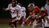 Ryan Skogg, #35,Heritage, runs in the first quarter of play against Rocky Mountain, Friday Nov. 9,...