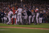 [7962]  Boston Red Sox teammates celebrate on the field after their 4-3 defeat of the Colorado...