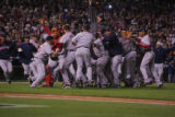 [7963]  Boston Red Sox teammates celebrate on the field after their 4-3 defeat of the Colorado...