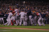 [7964]  Boston Red Sox teammates celebrate on the field after their 4-3 defeat of the Colorado...