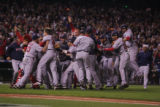 [7968]  Boston Red Sox teammates celebrate on the field after their 4-3 defeat of the Colorado...