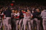 [7991]  Boston Red Sox teammates celebrate on the field after their 4-3 defeat of the Colorado...