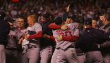 [7993]  Boston Red Sox teammates celebrate on the field after their 4-3 defeat of the Colorado...