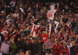 [8109]  Boston Red Sox fans celebrate as they watch their team defeat the Colorado Rockies 4-3 in...