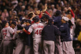 [8202]  Boston Red Sox teammates celebrate on the field after their 4-3 defeat of the Colorado...
