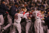 [8208]  Boston Red Sox teammates celebrate on the field after their 4-3 defeat of the Colorado...