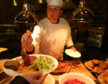 SH04I137MUSUEM Washington, Sept. 15, 2004 - Supervising chef, Albert Lukas, dishes a cranberry and...