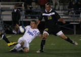 Broomfield's  #17 Nathan Seitz slides in to get the ball as Rock Canyon's #16 Nick Croley at ...