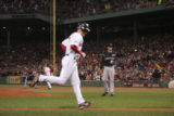 [ROX2918] Boston Red Sox Mike Lowell trots in after Colorado Rockies pitcher Ryan Speier walked...
