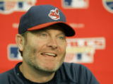 NY163 - ** FILE ** Cleveland Indians manager Eric Wedge laughs during his news conference before...