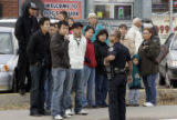 Bystanders watch as police secure a crime scene at the Ha Noi  restaurant at 1036 S. Federal Blvd....
