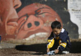 "3 year-old Osvaldo Lopez (cq) plays outside of the offices of ""Al Frente De Lucha"" after..."