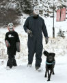 Scott Foor (cq), right and his son Luke Foor, walk their dog, Jack, during a break from skiing,...