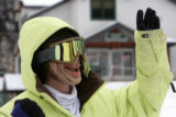 Cody DeDecker (cq) waves to some friends as he heads out for some boarding, wearing a mask,   at A...
