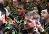 [Aurora, CO - Shot on: 9/30/04] Airman First Class David Sanders applauds as  Iraqi citizens Abid...