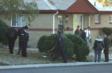 Adams County Crime  scene detectives search for bullet casings near W.  76th Ave. and Turner...