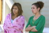 L to R: Marlene Gutierrez (cq), 17, and Christina Hernandez (cq),16, live  two homes away from the...