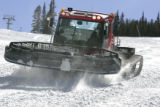 A snow cat woks on the lower portion of Main Vein, Thursday afternoon November 1, 2007, as crews...