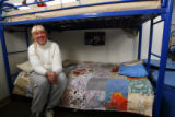 DM2937   Kris Schafer, 41,  sits on her bunk at The Delores Project, a womens homeless shelter and...
