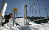 Matt Handrick (cq) ,moves snow as he helps to  set up the maze at the American Eagle lift ,...