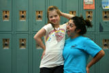 Fellow cheerleader Natalia Portillo (cq), right, goofs around with Megan Bomgaars (cq), left,...