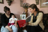 Ryan Moore, cq, (right) of Colorado Bright Beginnings visits the home of Yesenia Martinez and her...