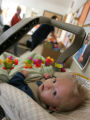 6 month old Jaden Sexton gazes at a volunteer as his mom, Karli Sexton and dad, Lee Sexton receive...