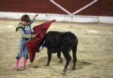(NYT19) MERIDA, Mexico -- Nov. 18, 2007 -- CHILD-BULLFIGHTERS -- Michelito Lagravere Peniche, 9,...