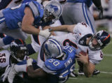 [EPS101] Denver Bronco quarterback Jay Cutler is sacked on fourth down by Detroit Lion defenders...