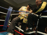 Stephen Blea, right, helps Rich Maez enter the ring for an introduction before the Fighting the...