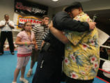 Rich Maez his hugged by long time friend Dan Alley with Den. Firefighter at the Police Protection...