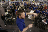 Best Buy manager Aaron Stanford, organizes store employees at the store at Colorado Blvd. and...