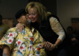 Mary Anne Anaya (cq) (r) gives Rich Maez a hug during the intermission of the boxing matches at...