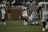 0022 Denver Broncos quarterback Jay Cutler kneels after being sacked in the second quarter against...