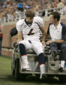 0430 Denver Broncos quarterback Jay Cutler leaves the field after being sacked in the second...