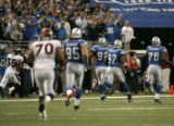 0593 Detroit Lions Shaun Rogers returns a 66 yard interception for a touchdown in the fourth...