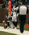 0616 Denver Broncos Dre Bly, left and Champ Bailey watch the clock the Detroit Lions continue to...