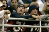 1100 A Denver Broncos fan looks stuned as he watches a replay of a play on the jumbotron as the...