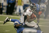 1158 Denver Broncos Brandon Marshall makes a ctahc against the Detroit Lions defense in the fourth...