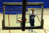 DM0097   Jeff Pierce, 29, warms up for a pick-up basketball game at the Northglenn Recreation...