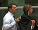 Cory Voorish, left, leaves the Alfred A. Arraj United States Courthouse, with his wife Paula...