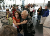 0216  Dr. Mike Henry, 73, of Lakewood, hugs his daughter-in-law Juli Henry, 53, as her and her...