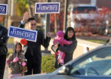 Denver school board candidate Arturo Jimenez (cq) at Speer Blvd. and Federal Tuesday morning ...