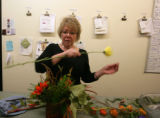 It's business as usual for florist, Jill Monsen as she creates a flower arrangement at The Flower...
