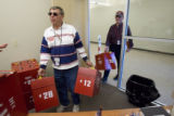 DM0718   Election officials Sal Troisi, left, and Tony Taylor, right, carry in empty ballot boxes...