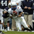SATURDAY SEPTEMBER 22ND, 2007 photo by Kirk Speer.  BYU's Ben Criddle (left), makes the stop after...